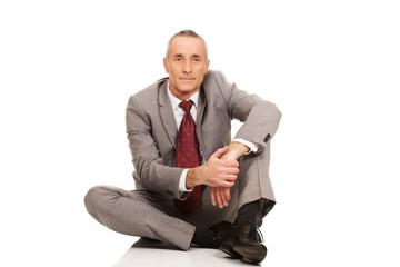 Businessman sitting on the floor