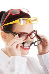 Portrait of a woman wearing many eyewear