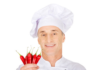 Male chef with chilli peppers