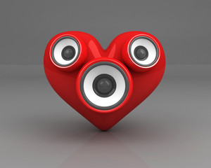 red heart with speakers over grey background