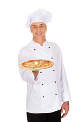 Chef baker with italian pizza