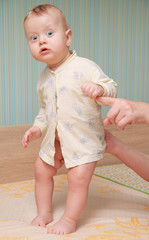 baby standing on a cot