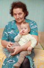 grandmother with her grandson on bed