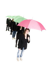 Group of people with umbrellas