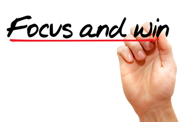 Hand writing Focus and win with marker, business concept