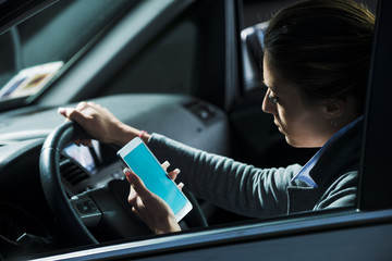 Woman using mobile while driving