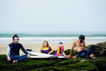 Group of professional surfers waiting for the big waves