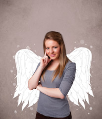 Young woman with angel illustrated wings