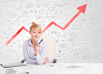Business woman sitting at table with market diagrams