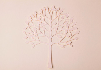 handmade paper tree silhouette on paper background