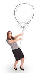 Pretty woman holding balloon drawing