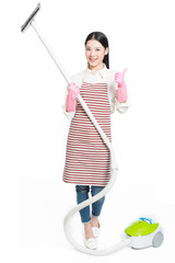 chinese young woman with a vacuum cleaner