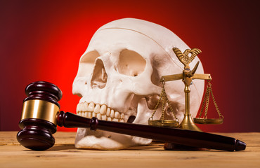 human scull  scales of justice and gavel
