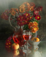 Wine, apple, persimmon and bouquet from chrysanthemums