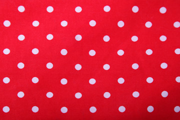 white and red polka dot background