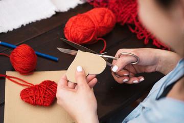 Creating red woolen heart
