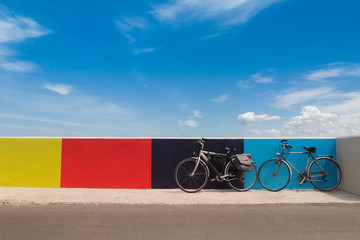 Two bicycles on the Italian embankment.