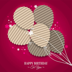 Birthday card with balloons in the style of flat folded paper.