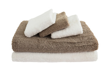 white and brown bath towels in stack isolated over white
