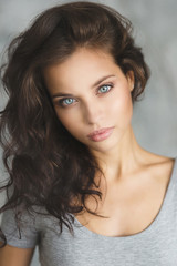 portrait of beautiful young girl in gray swimsuit