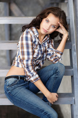 Beautiful young girl posing in jeans