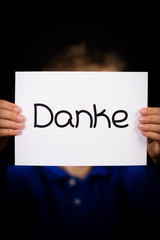 Child holding sign with German word Danke - Thank You