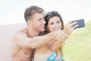 Young Couple on Vacation Taking Selfie