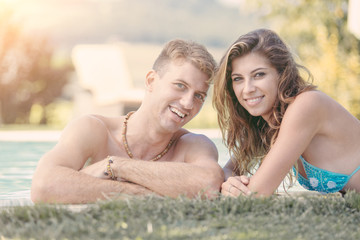 Beautiful Young Couple Next to Swimming Pool