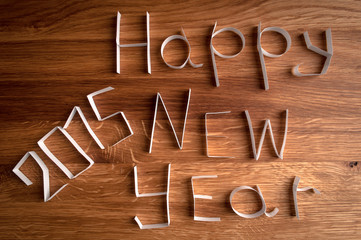 2015 Happy New Year paper on wooden background.