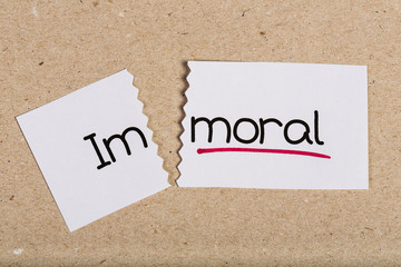 Sign with word immoral turned into moral