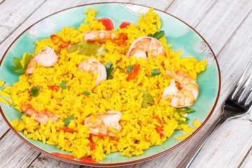 Shrimps Risotto garnished with parsley and red chili pepper
