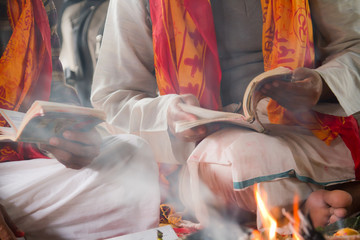 Brahmin reading hindu puja in Nepal