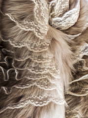 The product from from natural fur decorated by lace