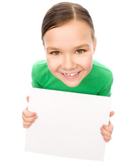 Happy little girl is holding blank board