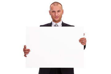 Unshaven businessman in a dark suit, holding a big sign, white