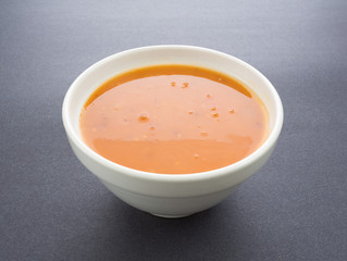 Bowl of tomato bisque with shrimp