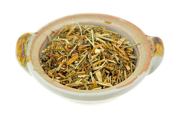 Bowl of St. Johns Wort on a white background