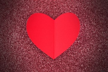 Red paper Valentines Day heart on glitter background
