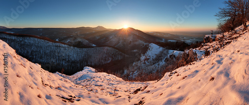 canvas print picture Panoramic view with man in winter mountain