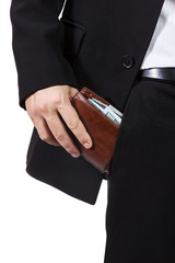 Male hand puts purse into his trouser pocket