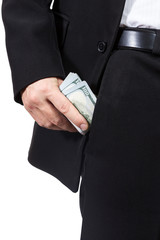 Male hand puts money into his trouser pocket