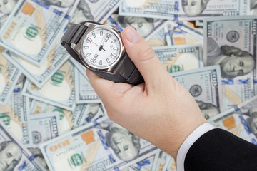 Wristwatch on dollars background