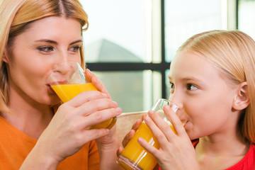 Enjoying fresh juice together.