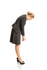 Businesswoman bending down