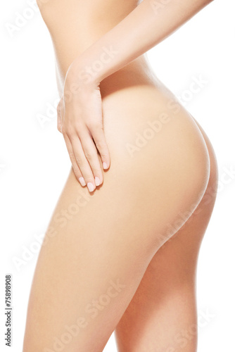 Side view of nude female slim body