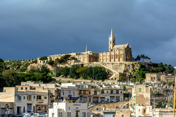 Mgarr village with Lourdes Church, Gozo, Malta