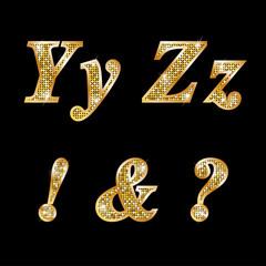 Golden metallic shiny letters Y, Z, !, ?, &