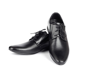 The black elegant men's shoes on the white isolated background