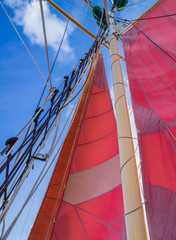 Red Sails and Rigging of Sailing Schooner Ship