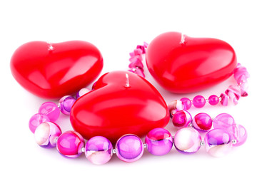 Red heart candles and pink necklace